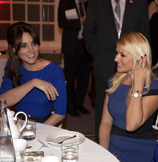 How lovely does Holly Willoughby look wearing Suzanne Neville at the 2015 Fostering Excellence Awards, pictured here with The Duchess of Cambridge.