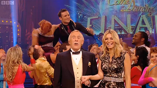 Tess Daly on BBC Strictly Come Dancing Grand Final in designer dress by Suzanne Enville