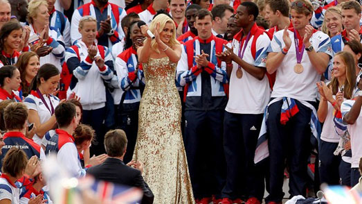 Katherine Jenkins sings anthem at Olympic Parade 2012 wearing gold designer dress by Suzanne Neville