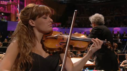 Nicola Benedetti wearing a black designer dress by Suzanne Neville