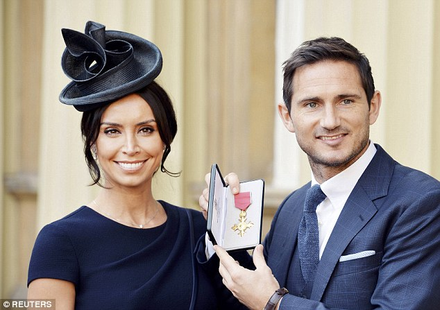 Christine Bleakley in her chic navy fitted pencil dress is from Suzanne Neville, a bridal and eveningwear designer