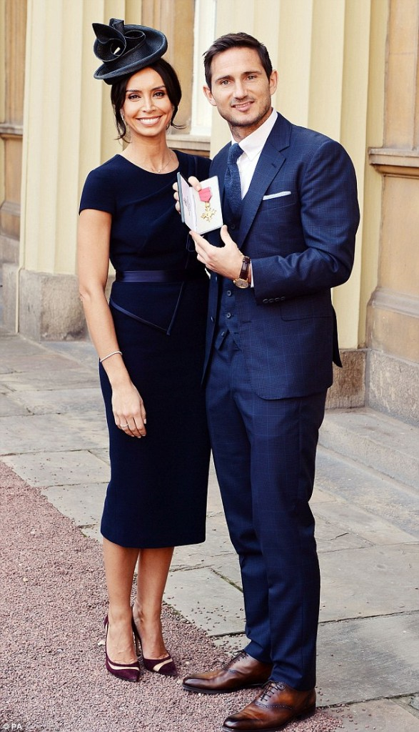 Frank Lampard accepts his OBE with Christine Bleakley wearing evening wear dress by fashion designer Suzanne NevilleBE evening wear dresses by fashion designer Suzanne Neville