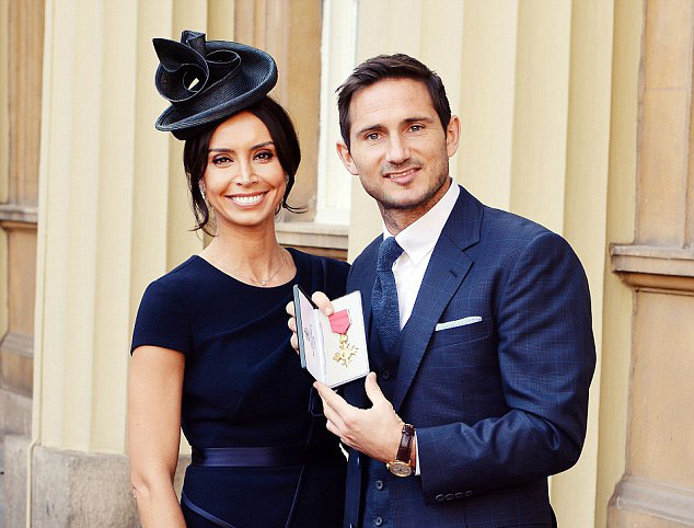 Frank Lampard accepts his OBE with Christine Bleakley wearing evening wear dress by fashion designer Suzanne Neville