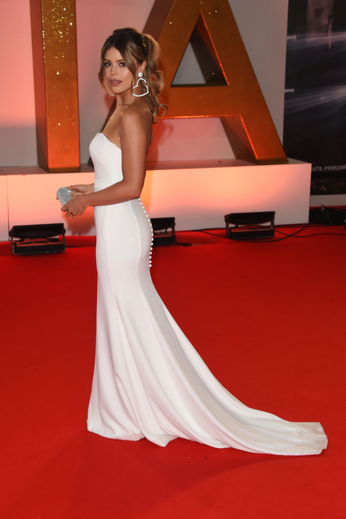 Chloe Lewis wearing Ivory Crepe Dress 'Mira' by designer Suzanne Neville